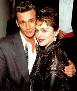 "Actor Luke Perry presents Madonna with the ""Award Of Courage"" on the behalf of the American Foundation for AIDS research."